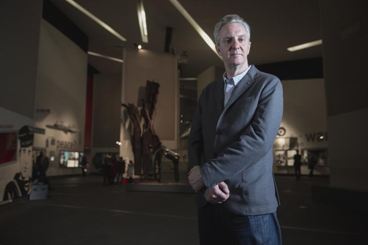 Leading poet Tony Walsh standing in the Main Exhibition Space at IWM North.