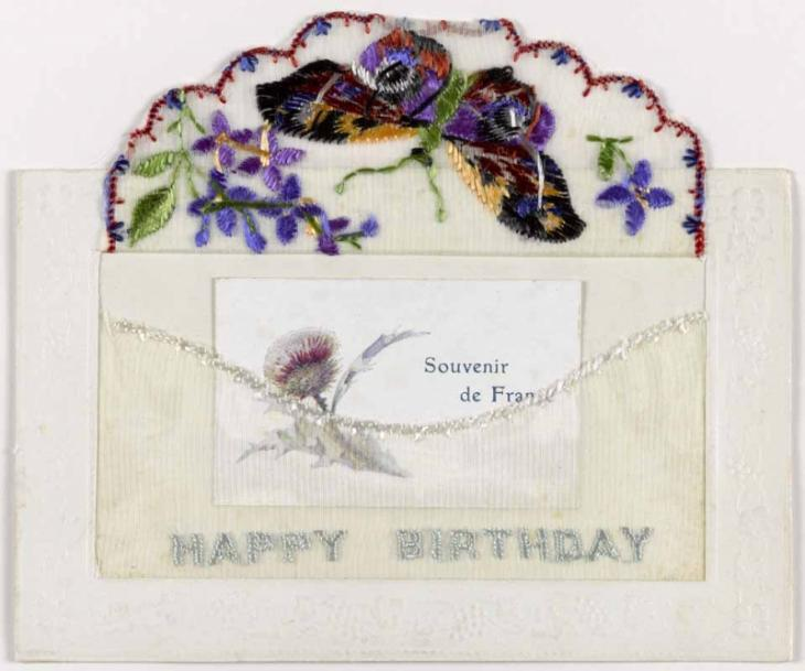 A silk postcard embroidered with a butterfly, with a secret pocket.