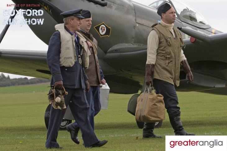 Costumed actors (pilots) in front of a Spitfire