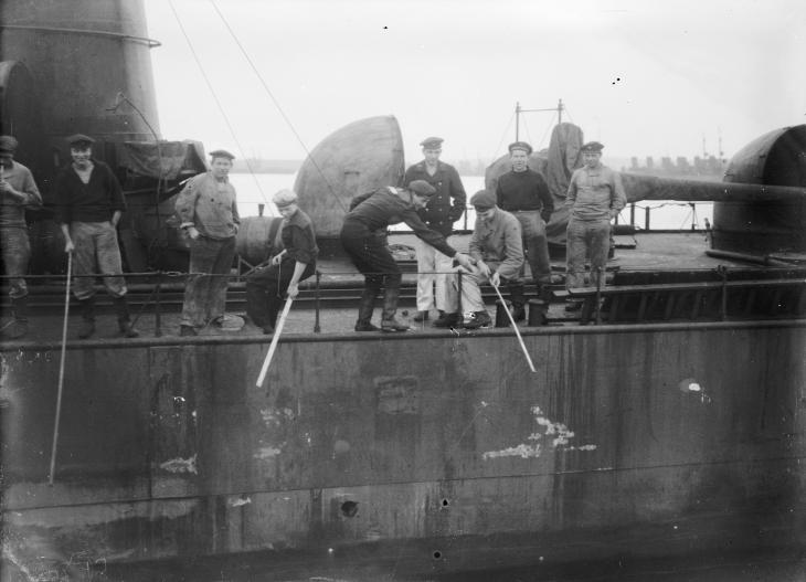 Internment at Scapa Flow 24 November 1918 - 20 June 1919: German sailors fishing from a destroyer in Scapa Flow.