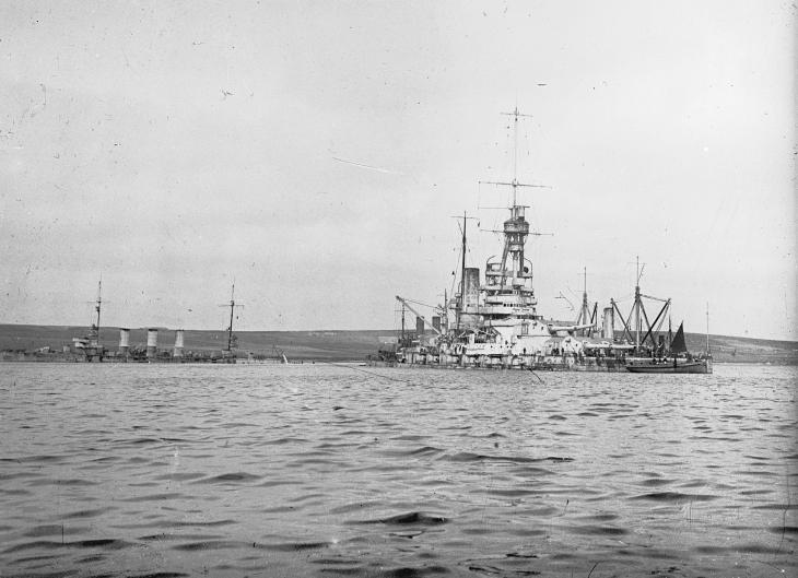 Salvage work in progress on the German battleship BADEN at Scapa Flow. The cruiser FRANKFURT is also in view.