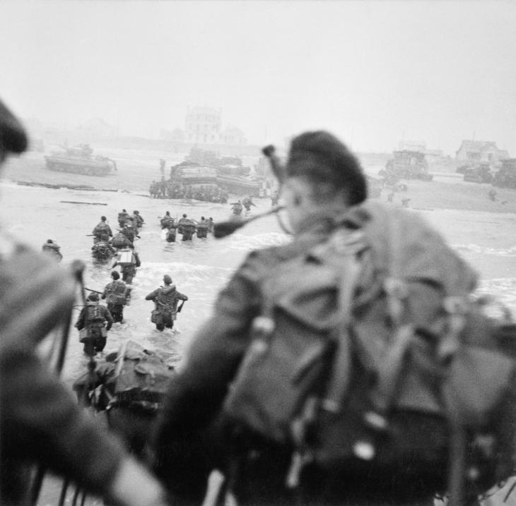 Commandos of 1st Special Service Brigade led by Brigadier Lord Lovat (in the water, to the right of his men) land on Queen Red beach, Sword area, c. 0840 hours, 6 June 1944.
