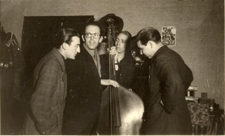 German swing kids crowded around a musician playing the double bass