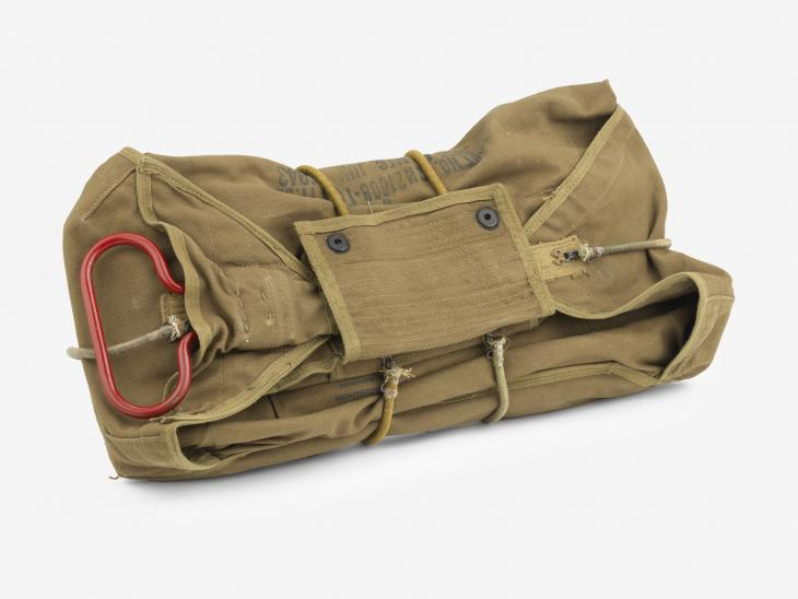 Photograph of reserve parachute chest pack of Private First Class Oscar Fred Prasse