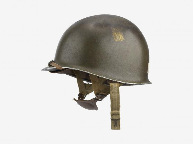 Photograph of the helmet worn by Sergeant Floyd Jakob 'Bud' Corrington of D Company, 506th Parachute Infantry Regiment, 101st Airborne Division on D-Day
