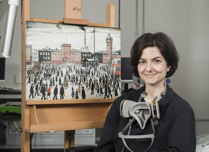 A conservator with LS Lowry's Going to Work