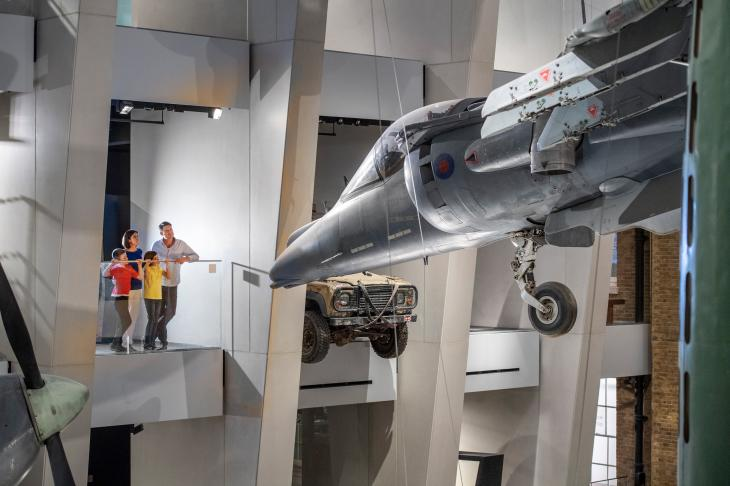Family looking at the Harriet Jet in the Atrium at IWM London