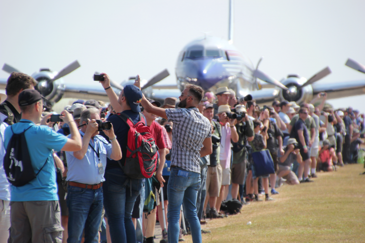 Visitors line up to see the Flying Bulls DC7 aircraft at Flying Legends
