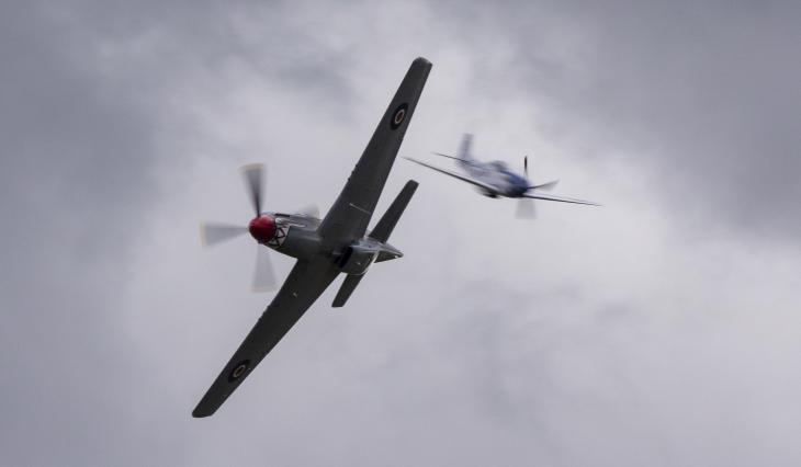 Pair of P-51 Mustangs in flight. One flying towards the camera